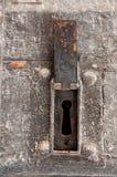 porte Temps-usée avec un grand trou de la serrure Photographie stock libre de droits