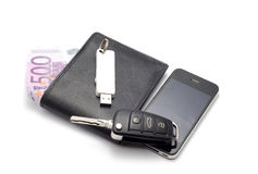 Portefeuille, autosleutel, smartphone. Stock Afbeelding