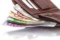 Portefeuille avec d'euro billets de banque sur le blanc Photographie stock libre de droits