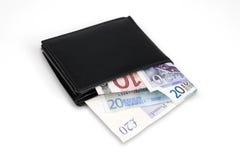 Portefeuille avec des billets de banque d'euro et de livre Photographie stock