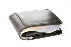 Portefeuille avec l'argent sur le fond blanc Photo stock