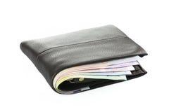 Portefeuille avec l'argent sur le fond blanc Image stock