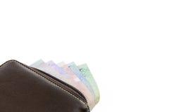 Portefeuille avec l'argent sur le fond blanc Photos libres de droits