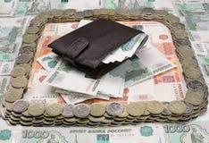 Portefeuille avec les factures d'argent millièmes images stock