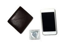Portefeuille, celtelefoon en condoom royalty-vrije stock foto's