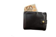 Portefeuille en cuir noir complètement d'argent Photographie stock libre de droits