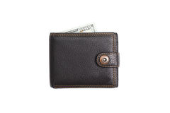 Portefeuille en cuir noir fermé avec des dollars d'argent liquide Photos stock