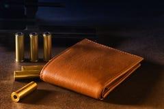 Portefeuille et armes Image stock