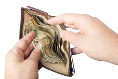 Portefeuille gehouden met contant geld open royalty-vrije stock foto's