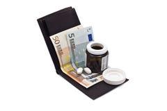 Portefeuille met geld en geneeskunde Stock Fotografie
