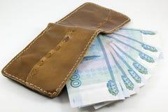 Portefeuille met Russische roebels op een witte achtergrond Stock Afbeelding