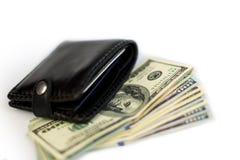 Portefeuille noir avec des dollars Image libre de droits
