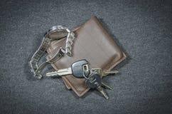 Portefeuilles en autosleutel van polshorloge Royalty-vrije Stock Afbeelding