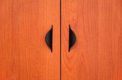 Portelli di armadietto di legno Fotografie Stock