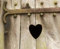 Portello di legno con cuore Fotografie Stock