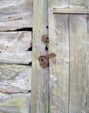 Portello di legno con la serratura Fotografia Stock