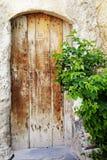 Portello di legno portato vecchio tempo Fotografie Stock