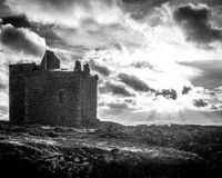 Portencross Castle Scotland. During a storm with the sun coming through the clouds Royalty Free Stock Photo
