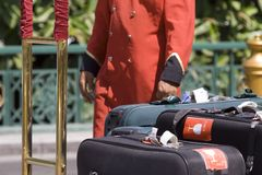 Porter. And luggage at luxury hotel royalty free stock photos
