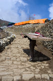 Porter carry heavy load in Namche Bazar , Nepal Stock Photo