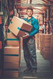 Porter carrying boxes i Stock Image