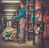 Porter carrying boxes Royalty Free Stock Image