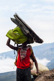 Porter carrying heavy load Stock Photos
