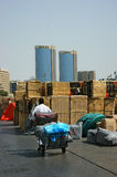 Porter driven cart with packs in Port Said stock images