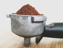 Porter filter handle with ground coffee beans Royalty Free Stock Images