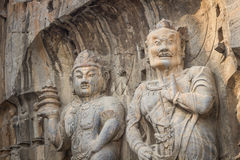 Porter's statue rock carving at Longmen Grottoes, Luoyang , Hena Stock Photography