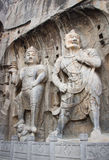 Porter's statue rock carving at Longmen Grottoes, Luoyang , Hena Royalty Free Stock Photography