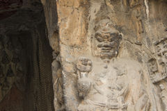 Porter's statue rock carving at Longmen Grottoes, Luoyang, Henan Royalty Free Stock Photo