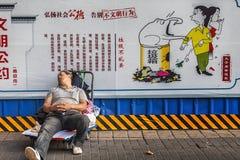 Porter sleeping on a trolley Royalty Free Stock Photos
