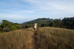 Porter walking trekking route heavy big basket Royalty Free Stock Photos
