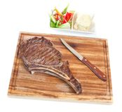 Porterhouse meat. Grilled porterhouse meat on cutting board with knife Royalty Free Stock Images
