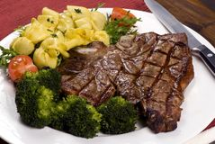 Porterhouse Steak 002. A mouth watering porterhouse steak with fresh vegetables and pasta Stock Image
