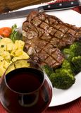 Porterhouse Steak 003. A mouth watering porterhouse steak with fresh vegetables and pasta Stock Images