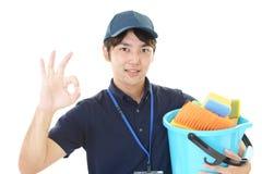 Portero asiático sonriente foto de archivo
