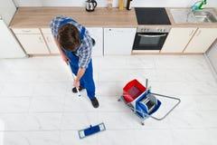 Portero Cleaning Floor Fotografía de archivo