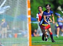Portero de las muchachas de la juventud del lacrosse Fotos de archivo