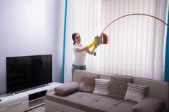 Portero de sexo femenino Cleaning Electric Light imagen de archivo libre de regalías