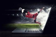 Portero del fútbol en la acción Técnicas mixtas Foto de archivo libre de regalías