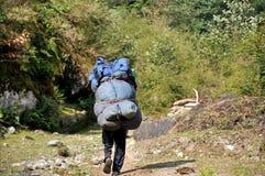 Portero en el Himalaya Fotos de archivo