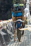 Porters carry heavy load in Himalaya Royalty Free Stock Photos