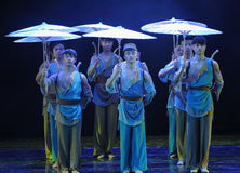 The porters group with an umbrella-The dance drama The legend of the Condor Heroes. In December 2, 2014, a large Chinese dance drama the legend of the Condor Stock Image