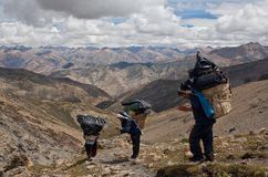 Porters with heavy load in the Himalaya Stock Photography