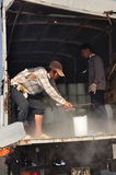Porters are shaving ice at the local seaport of Con Dao island of Vietnam Stock Photos