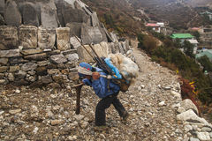 Porters in the village of Pangboche Royalty Free Stock Images