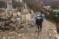 Porters in the village of Pangboche Stock Images