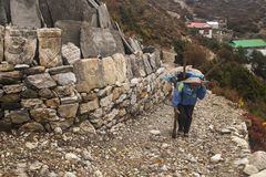 Porters in the village of Pangboche Stock Image